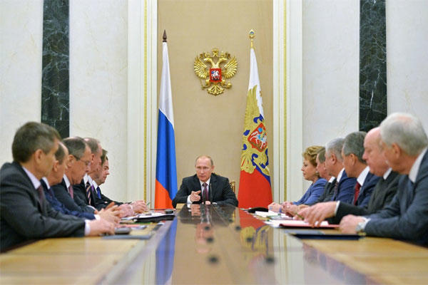 Russian President Vladimir Putin, center, heads the Security Council in Moscow's Kremlin, Russia on Friday, Dec. 26, 2014. (Alexei Druzhinin, RIA Novosti/PPS/AP)