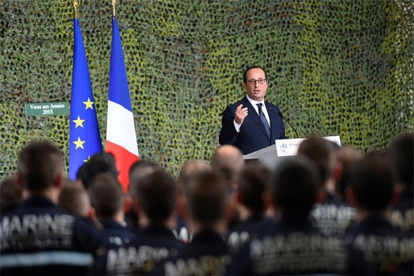 French President Francois Hollande delivers a speech during his visit on the French nuclear aircraft carrier Charles de Gaulle to present his New Year wishes to the French military troops, Wednesday, Jan. 14, 2015. (AP Photo/Anne Christine Poujoulat)