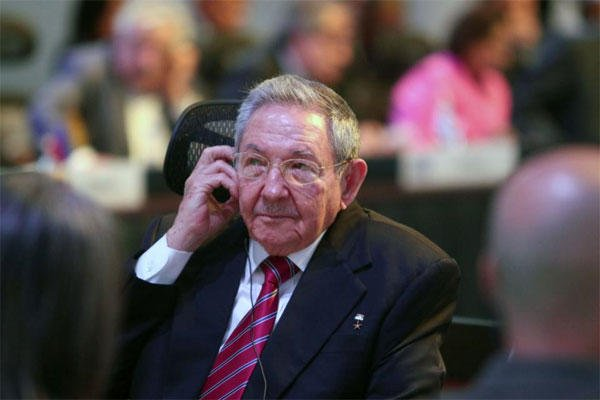 Cuba's President Raul Castro listens on a headphone during the summit of the Community of Latin American and Caribbean States in Costa Rica, Wednesday, Jan. 28, 2015. (AP Photo/Presidency of the Republic of Costa Rica, Roberto Carlos Sanchez)