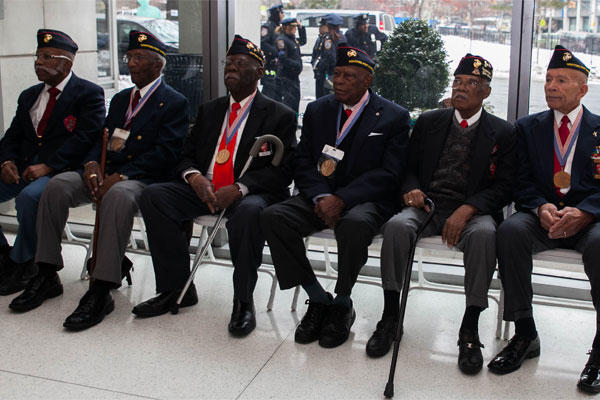 Surviving Montford Point Marines attend a ceremony for Sgt. Hiram L. Knowles to be awarded the Congressional Gold Medal on Feb. 7, 2015. Photo By: Cpl. Elizabeth Thurston