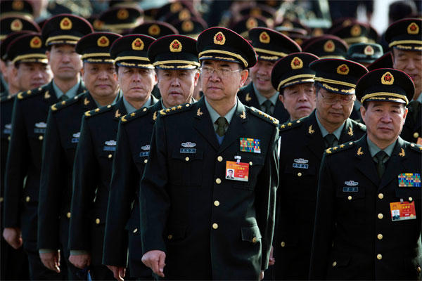 Chinese military officers arrive at the Great Hall of the People in Beijing, Wednesday, March 4, 2015. (AP Photo/Ng Han Guan)