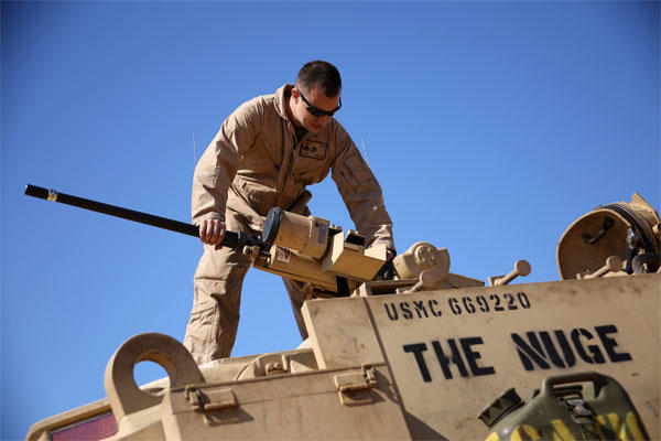 Marine Corps Sgt. Cody Olson assembles an M2 .50-caliber heavy machine gun on an M88A2 Hercules Armored Recovery Vehicle during an exercise Feb. 8, 2015. (U.S. Marine Corps photo by Sgt. Devin Nichols)