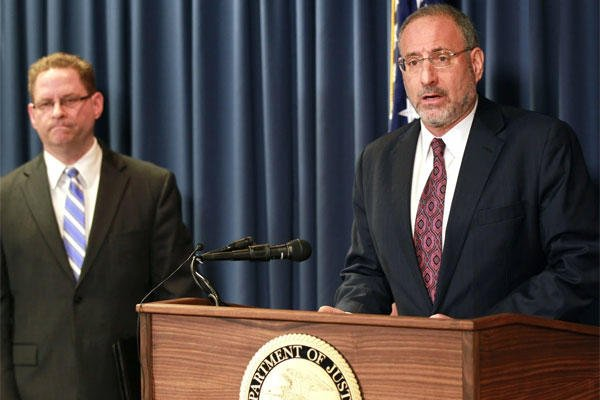 United States Attorney Andrew Luger, right, and FBI special agent Richard Thornton explain the criminal complaint charging six Minnesota men with terrorism at a news conference in Minneapolis, Monday April 20, 2015. (Andy Clayton-King/Associated Press)