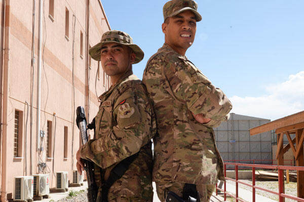 Childhood friends Air Force Staff Sgt. Vincent Fulgencio, left, and Air Force Maj. Gregory Savella pose for a photo at Bagram Airfield, Afghanistan, May 19, 2015. (U.S. Air Force photo by Senior Airman Cierra Presentado)