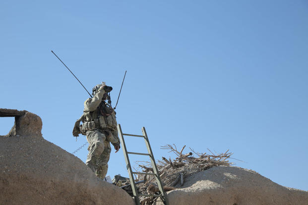 A combat controller, deployed with a U.S. Army Special Forces team in Afghanistan, searches for targets to provide close air support during an engagement with insurgents. (U.S. Air Force photo)