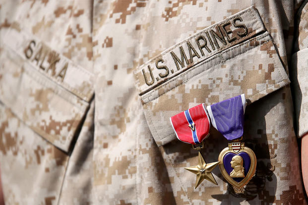 U.S. Marine 1st Lt. James P. Salka wears his Bronze Star Medal with combat distinguishing device and Purple Heart after an awards ceremony at Marine Corps Base Camp Lejeune, N.C., June 8, 2015. (U.S. Marine Corps photo/Cpl. Joshua Brown)