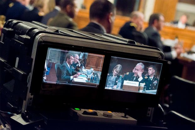 Defense Secretary Ash Carter and Chairman of the Joint Chiefs of Staff Gen. Martin E. Dempsey are shown on video monitors during testimony before the U.S. Senate Committee on Armed Services committee, July 7, 2015. (DoD photo/Army Staff Sgt. Sean K. Harp)