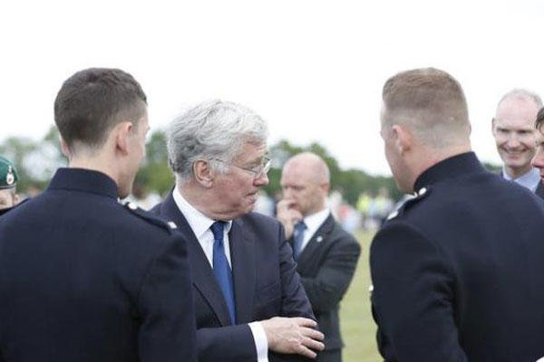 File Photo shows Defence Secretary Michael Fallon listening to Royal Marines at the Armed Forces Day National Event in Guildford, Britain, 27 June 2015. (Photo: British Ministry Of Defense)