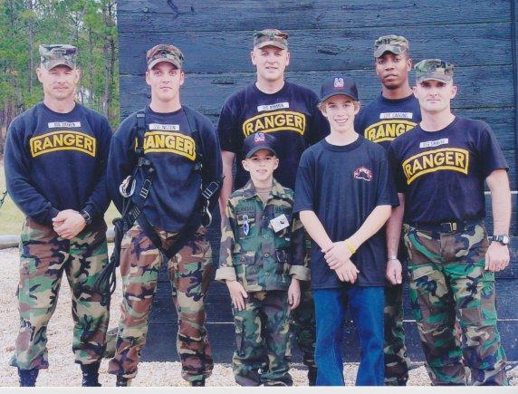 Evan Schneider, once a Make-A-Wish Foundation recipient, stands with his brother, Austin, and a group of Rangers from the Ranger Training Brigade, who he met in 2004. Schneider's dream was to become an Army Ranger. (Photo: U.S. Army)