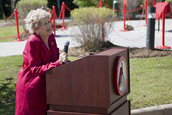 Betsy Fowler, widow of Col. James Fowler founder of the Marine Corps Marathon, speaks at the Marine Corps Marathon building dedication at Marine Corps Base Quantico, Virginia, Sept. 14, 2015. (U.S. Marine Corps/Sgt. Melissa Karnath)