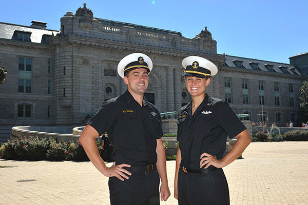Midshipmen 1st Class Andrew Whisner, left, and Anna Wade stand in Tecumseh Court at the U.S. Naval Academy. Whisner and Wade are both prior enlisted Sailors accepted into the academy while on active duty. (U.S. Navy/David S. Tucker)
