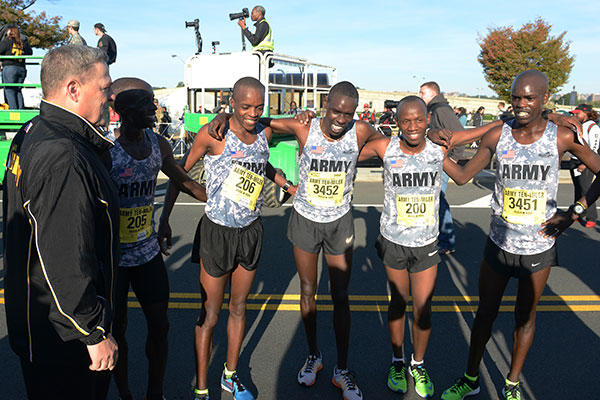 Chief of Staff of the Army Gen. Mark A. Milley (left), meets with the top four race finishers, including Paul Chelimo Nicholas Kipruto, and Shadrack Kipchirchir. (U.S. Army/David Vergun)