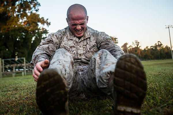 Pfc. Brandon Tressler, scout sniper screener candidate from 3rd Battalion, 6th Marine Regiment, conducts a max set of sit-ups- after completing a 1.5 mile ruck run at Camp Lejeune, N.C., Oct. 20, 2015. (U.S. Marine Corps/Cpl. Kirstin Merrimarahajara)