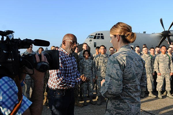 Al Roker speaks with Col. Michele Edmondson, the 81st Training Wing commander, following Roker's weather report during a segment of the Today Show on the flightline at Keesler Air Force Base, Miss. Nov. 11, 2015. (U.S. Air Force/Kemberly Groue)