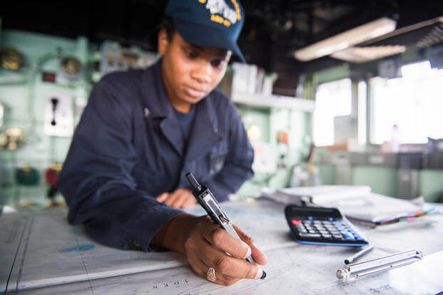 Quartermaster 3rd Class Monica Christopher plots a course aboard the Whidbey Island-class dock landing ship USS Rushmore (LSD 47). (Photo by Mass Communication Specialist 3rd Class Chelsea Troy Milburn)