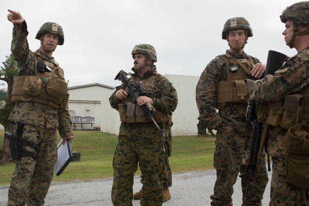 Capt. Albert Bellamy, far left, points to where he wants a security checkpoint setup at Camp Courtney in Okinawa, Japan, Dec. 15, 2015. (Photo: Lance Cpl. Carl King)