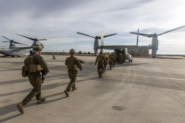 U.S. Marines with Special-Purpose Marine Air-Ground Task Force Crisis Response-Africa load up an MV-22B Osprey during a tactical recovery of aircraft and personnel exercise, Dec. 7, 2015, at Los Llanos Air Base, Spain. Photo: Staff Sgt. Vitaliy Rusavskiy