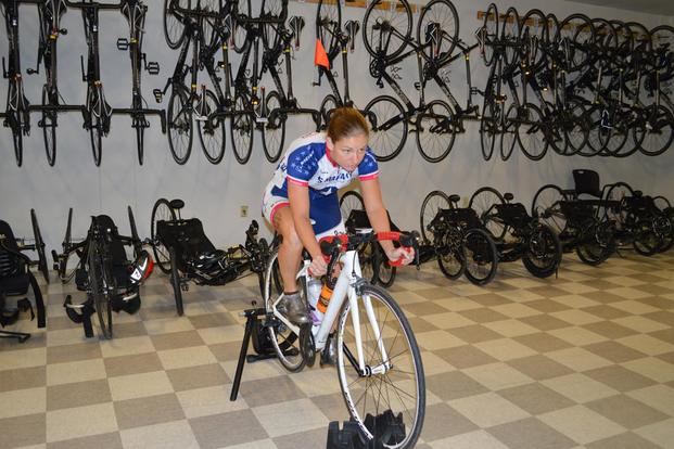 Army Sgt. 1st Class Samantha Goldenstein rides an indoor trainer at the Brooke Army Medical Center Warrior Transition Battalion at Joint Base San Antonio, Texas, Nov. 17, 2015. (Photo: Lori Newman)