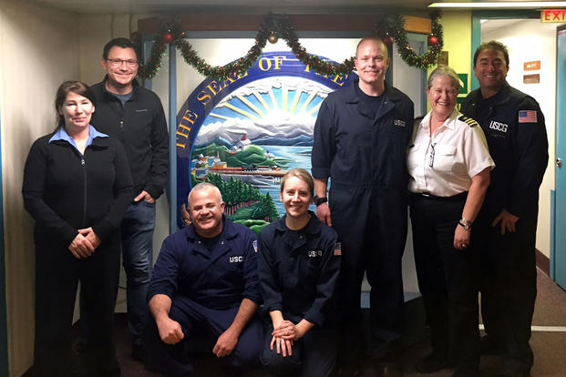 Lt. Ryan Butler, Lt. j.g. Katharine Martorelli, Chief Warrant Officer Israel Nieves and Chief Warrant Officer Martin Donohue from Sector Juneau, Alaska, along with vessel Master Captain Josh McGrath and two other crewmembers. (U.S. Coast Guard photo)