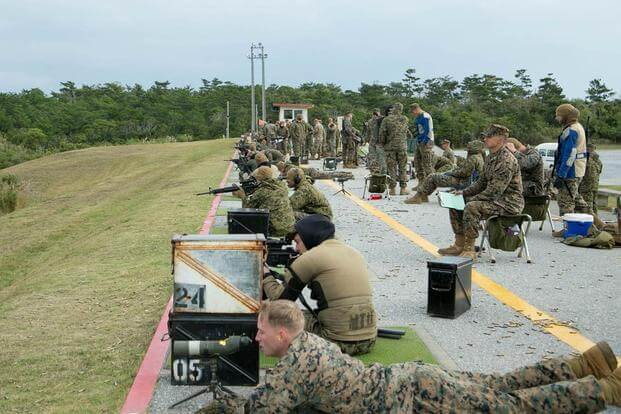 Shooters fire on their targets during the Far East Division Marksmanship Match Dec. 17 aboard Camp Hansen, Okinawa, Japan. (Photo: Lance Cpl. Doug Simons)