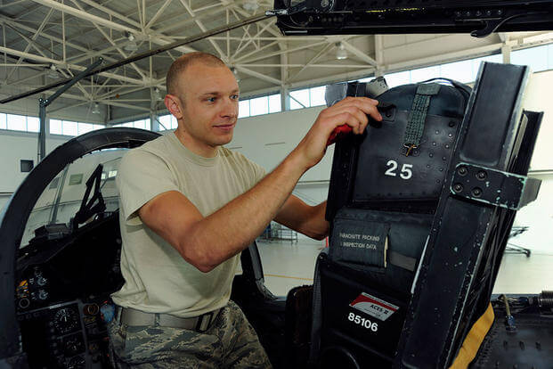 Tech. Sgt. Dwayne Farr, an egress repairman, inspects an F-15 Strike Eagle seat at Portland Air National Guard Base, Ore., July 9, 2013. (U.S. Air National Guard Photo/Tech. Sgt. John Hughel)
