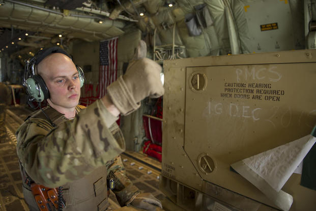 Staff Sgt. Justin King, a 774th Expeditionary Airlift Squadron loadmaster, gives a thumbs-up as a generator is offloaded from a C-130J Super Hercules at Camp Bastion, Afghanistan, Jan. 3, 2016. (U.S. Air Force photo/Tech. Sgt. Robert Cloys)
