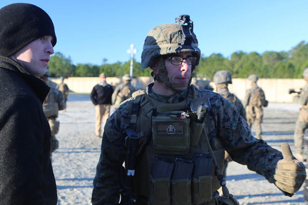 Staff Sgt. Michael Cucinotta, a platoon sergeant with 2nd Battalion, 2nd Marine Regiment, gives instructions to a refugee role player during a noncombatant evacuation training operation at Marine Corps Base Camp Lejeune, North Carolina, Jan. 14, 2016. (Ph