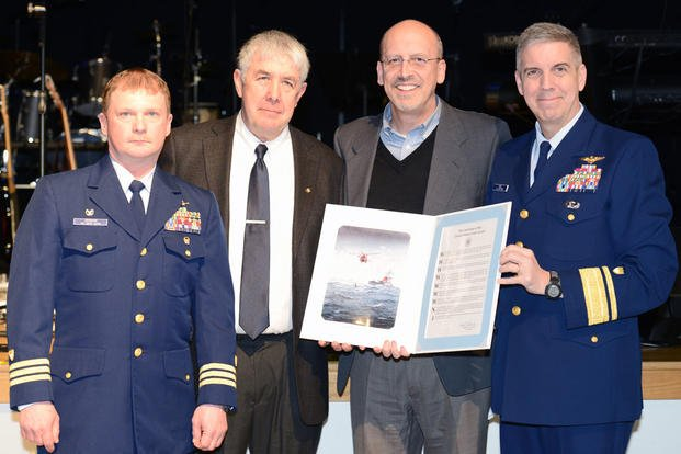 "Cmdr. Jack W. Jackson, Bob Siversten, Dave Landis and Rear Adm. Dan Abel, Coast Guard 17th District commander display the proclamation declaring Ketchikan, Alaska, ""A Coast Guard City"", Jan. 30, 2016. (Photo: Petty Officer 3rd Class Meredith Manning)"