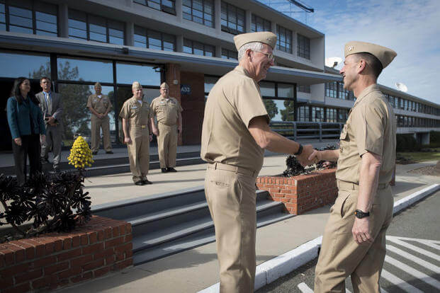 Chief of Naval Operations Adm. John Richardson is greeted by Rear Adm. David Lewis, commander, Space and Naval Warfare Systems Command at SPAWAR Systems Center Pacific. (Photo: Mass Communication Specialist 1st Class Nathan Laird)