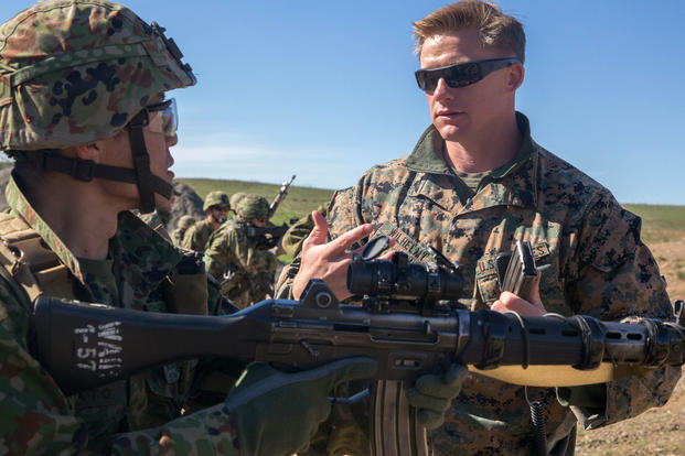 Sgt. Mason Wilhelmy discusses the Japan Ground Self-Defense Force's Western Army Infantry Regiment's Scout Sniper program with Sgt. First Class Kusumato at Marine Corps Base Camp Pendleton, Calif., Feb. 1, 2016. (Photo: Lance Cpl. Timothy Valero)