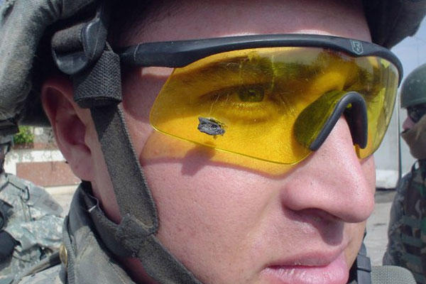 In this Feb. 6, 2006 file photo, 1st Lt. Anthony Aguilar wears the ballistic protective eyewear that prevented a bomb fragment from possibly damaging his eyes when an improvised explosive device detonated near his Stryker vehicle in Iraq. U.S. Army photo