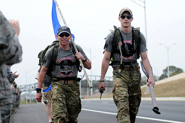 15 Marines and three civilians started a 770-mile ruck from Navarre, Florida, to Marine Corps Base Camp Lejeune, North Carolina to honor 11 service members who died in a helicopter crash one year ago. (Photo: Katie Lange)