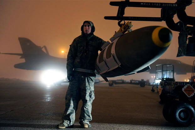 Airman Michael Doto, a 28th Aircraft Maintenance Squadron weapon systems technician, steadies a GBU-31 joint direct attack munition while preparing to load it on a B-1B Lancer on Ellsworth AFB, S.D., March 27, 2011. (Photo: Staff Sgt. Marc I. Lane)