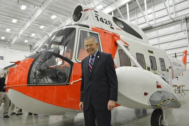 Retired Rear Adm. Robert Johanson stands before HH-52A Seaguard helicopter, tail number 1426, at Coast Guard Aviation Logistics Center in Elizabeth City, N.C., Friday, Dec. 11, 2015. (Photo: Petty Officer 2nd Class Nate Littlejohn)