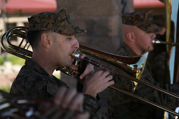 Staff Sgt. Alexander Panos, a trombone player with the 1st Marine Division Band, rehearses alongside his fellow Marines aboard Marine Corps Base Camp Pendleton, Nov. 23, 2015. (Photo: Cpl. Will Perkins)