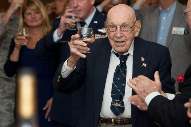 Retired Lt. Col. Dick Cole, a co-pilot in the Doolittle Raid on Tokyo, raises a glass to toast the 74th anniversary of the raid on April 18, 2016, at Joint Base San Antonio-Randolph, Texas. (Photo: Airman 1st Class Stormy Archer)