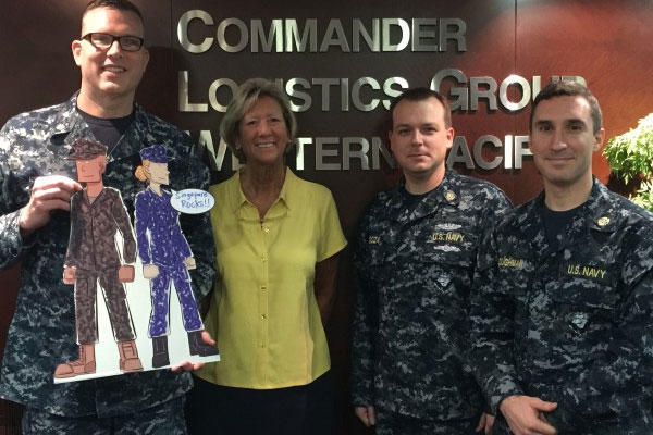 Jill Loftus, center, director of the Department of the Navy's Sexual Assault Prevention and Response Office, with Lt. Cmdr. Patrick Lahiff, Chief Legalman James Goza, and Lt. Kevin Loughman during her visit to Navy Region Center Singapore. (U.S. Navy)