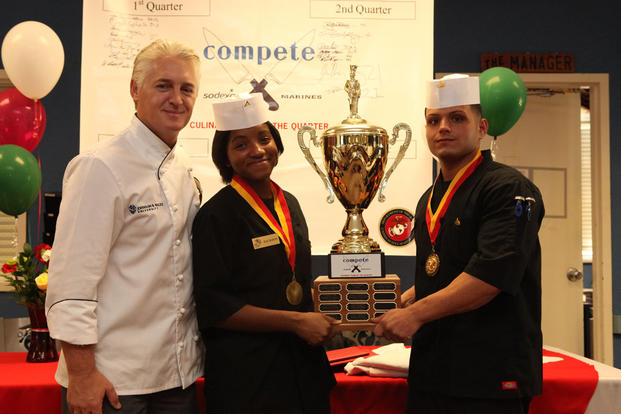 Mark Allison, the dean of culinary arts for Johnson and Wales University, with Lance Cpl. Charmaine Jackson and Cpl. Frank Cala after they won the third quarter Culinary Team of the Quarter, Oct. 18, 2011. (U.S. Marine Corps/Cpl. Damany S. Coleman)