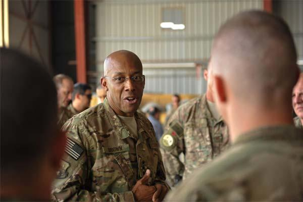 U.S. Air Force Lt. Gen. Charles Q. Brown Jr. talks with Airmen assigned to the 738th Air Expeditionary Air Advisor Group at Kandahar Airfield, Afghanistan, July 25, 2015. (U.S. Air Force photo by Maj. Tony Wickman/Released)