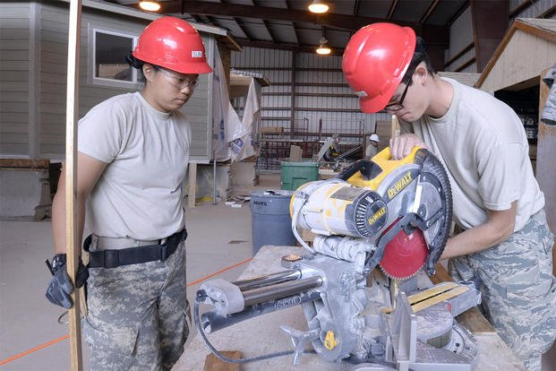Cadets at the U.S. Air Force Academy use a saw while building two homes for the Navajo Nation June 22, 2016. The cadets are participating in the Academy's Field Engineering and Readiness Laboratory. (U.S. Air Force photo/Mike Kaplan)