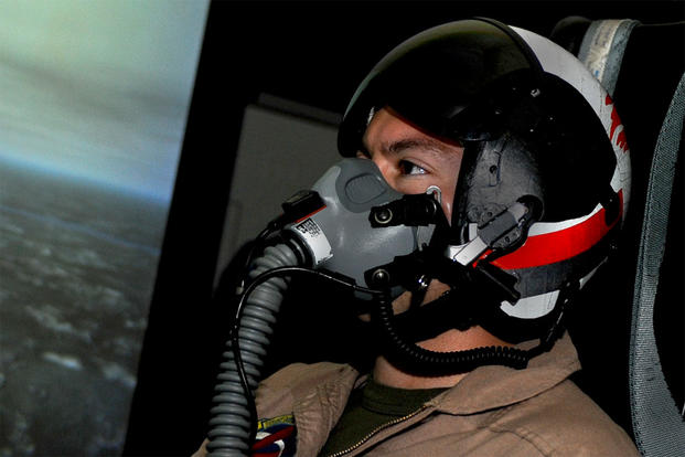 Marine Corps Maj. Kevin Ryan undergoes oxygen deprivation training while operating Naval Air Warfare Center Aircraft Division's Manned Flight Simulator at Patuxent River Naval Air Station. (U.S. Navy Photo)
