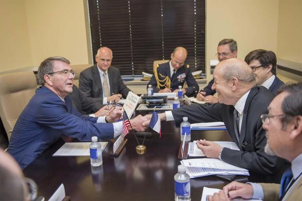 Ash Carter shakes hands with French Defense Minister Jean-Yves Le Drian at a meeting of defense ministers from the coalition to counter ISIS at Joint Base Andrews, Md., July 20, 2016. (DoD photo by Air Force Tech. Sgt. Brigitte N. Brantley)