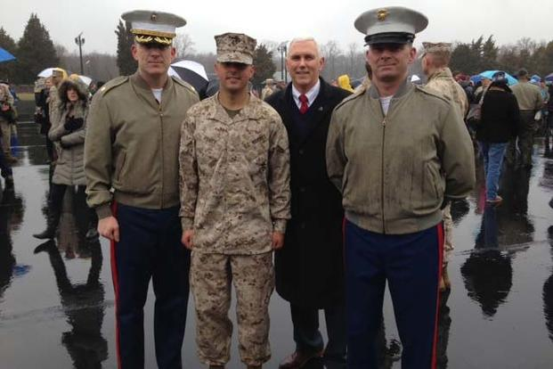 Indiana Gov. Mike Pence joins his son, Marine 2nd Lt. Michael J. Pence, second from left, during Michael Pence's Officer Candidate School graduation aboard Marine Corps Base Quantico, Virginia, March 20, 2015. Sgt Tyler S. Mitchell/Marine Corps