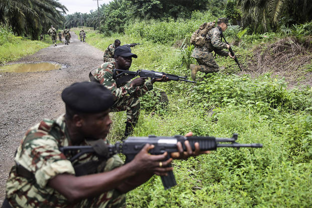 Cpl. Mitchell York rushes forward during a simulated contact left attack during a patrolling exercise with Cameroonian soldiers in Limbé, Cameroon, June 28, 2016. (Photo: Cpl. Alexander Mitchell)