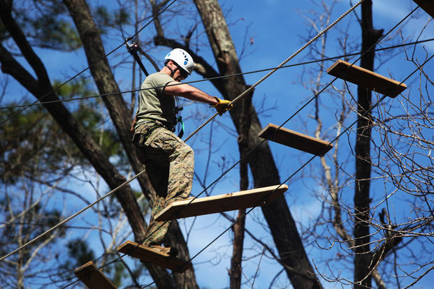 Capt. Timothy G. Otto maneuvers across a wooden rope bridge during the Devil Dog Dare Challenge Course at Marine Corps Air Station Cherry Point, N.C., March 10, 2016. (U.S. Marine Corps photo by Pfc. Nicholas P. Baird/Released)