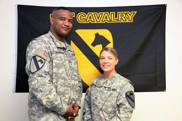 FILE -- Maj. Khallid Shabazz, then chaplain for the 1st Air Cavalry Brigade, 1st Cavalry Division, and Sgt. Jessica N. Covello, 1st ACB chaplain assistant pose in their office at Fort Hood, Texas, Aug. 8, 2013. (Photo Credit: Sgt. Christopher Calvert)