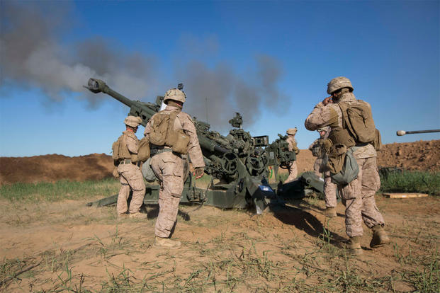 U.S. Marines with Task Force Spartan, 26th Marine Expeditionary Unit (MEU), fire a M777A2 Howitzer on an ISIS infiltration route in support of Operation Inherent Resolve, on Fire Base Bell, Iraq, March 18, 2016. (U.S. Marine Corps photo/Cpl. Andre Dakis)