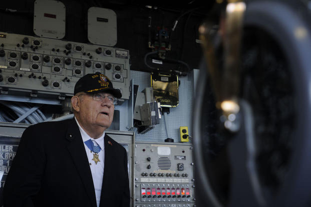 Arthur J. Jackson tours the bridge of the amphibious assault ship USS Peleliu. Jackson was awarded the Medal of Honor for bravery at the Battle of Peleliu during World War II, for which the ship was named. (U.S. Navy/Seaman Apprentice Alex Van'tLeven)