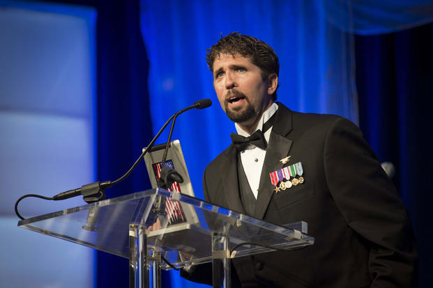 Retired Navy SEAL Lt. Jason Redman, a wounded warrior who turned motivation speaker and wounded warrior advocate, speaks as the keynote speaker at the U.S. Navy Birthday Ball in Washington, D.C., Oct. 12, 2013. (U.S. Navy photo/ Peter D. Lawlor)