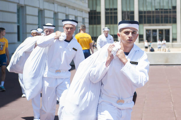 Incoming plebes from the U.S. Naval Academy class of 2020 carry laundry bags to Bancroft hall during induction day (I-day), June 30, 2016. (U.S. Navy photo/Mass Communication Specialist Second Class Jonathan L. Correa)